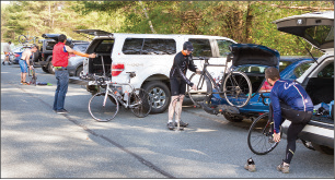 Riders prepare their bikes for the Wednesday night group ride from the Bike Hub on Route 5 in Norwich.