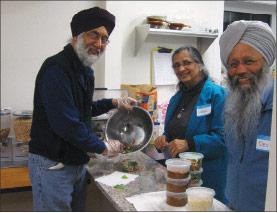 Volunteer cooks Harjit Rakra, Sukhbir Sodhi and Devinder Sodhi