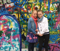 Emma Neuman and Greta Holland by the Lennon wall