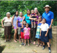Mae Butler, surrounded by new family and friends in Panama