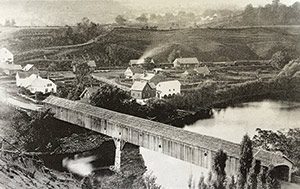 The Ledyard Free Bridge, with Lewiston in the background and Norwich over the hill, circa 1880.
