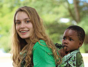 Lyla Stettenheim, Norwich, learning how Zambian women carry thei r children on their backs.