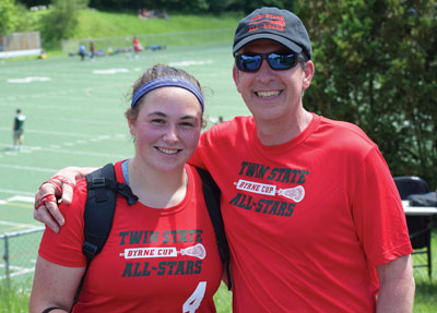 Sophie credits much of her success to great coaching, pictured here with Coach Chris Seibel.