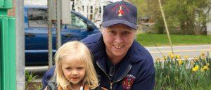 Linda Cook and her firefighter helper, Ella Sweet