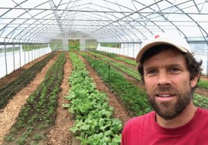 Chuck Wooster in one of Sunrise Farm's greenhouses