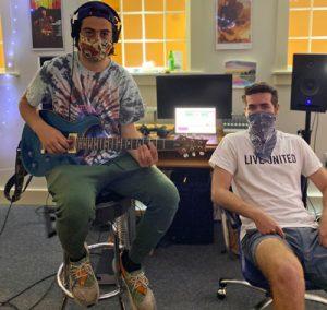 Hanover High School alumni Noah Kahan and Phin Choukas in the studio